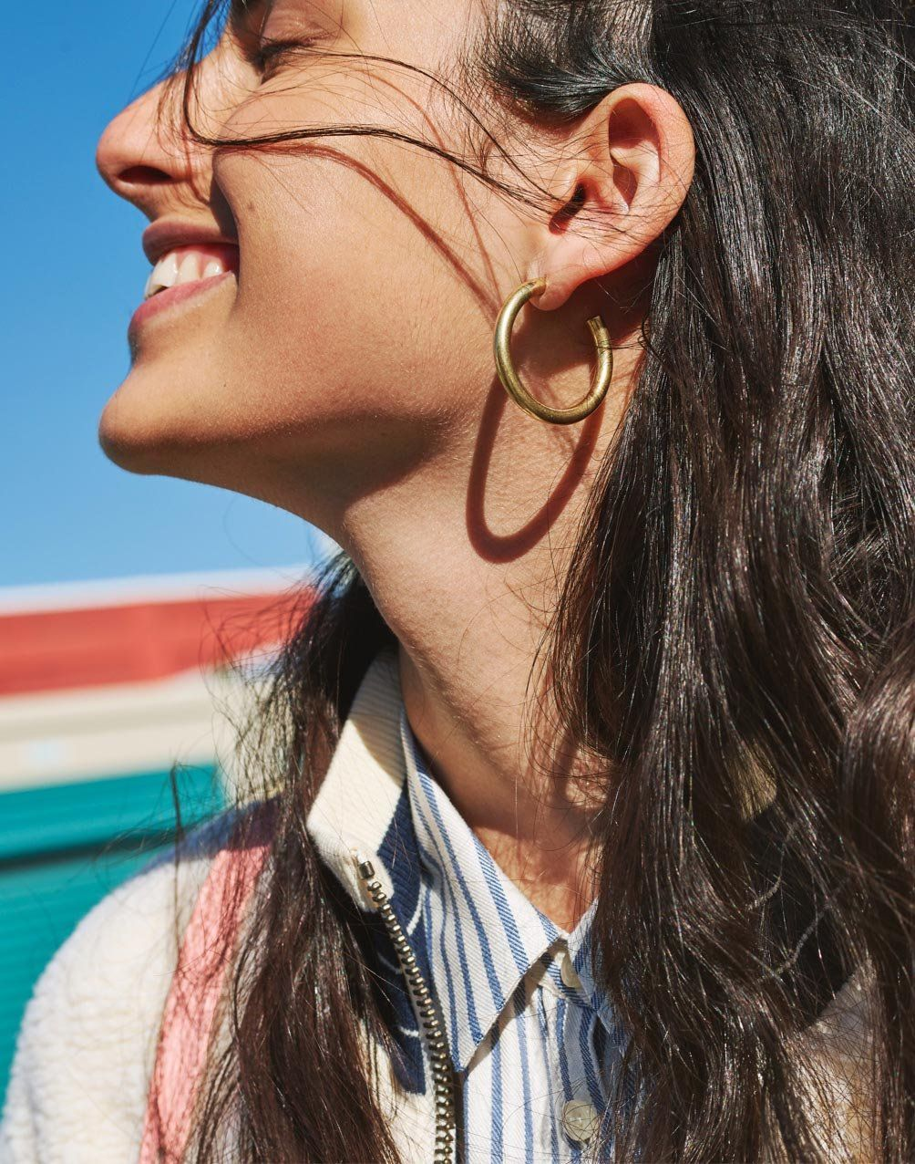 eeb13e1bb95663 madewell chunky medium hoop earrings worn with sherpa varsity bomber jacket  + central shirt.