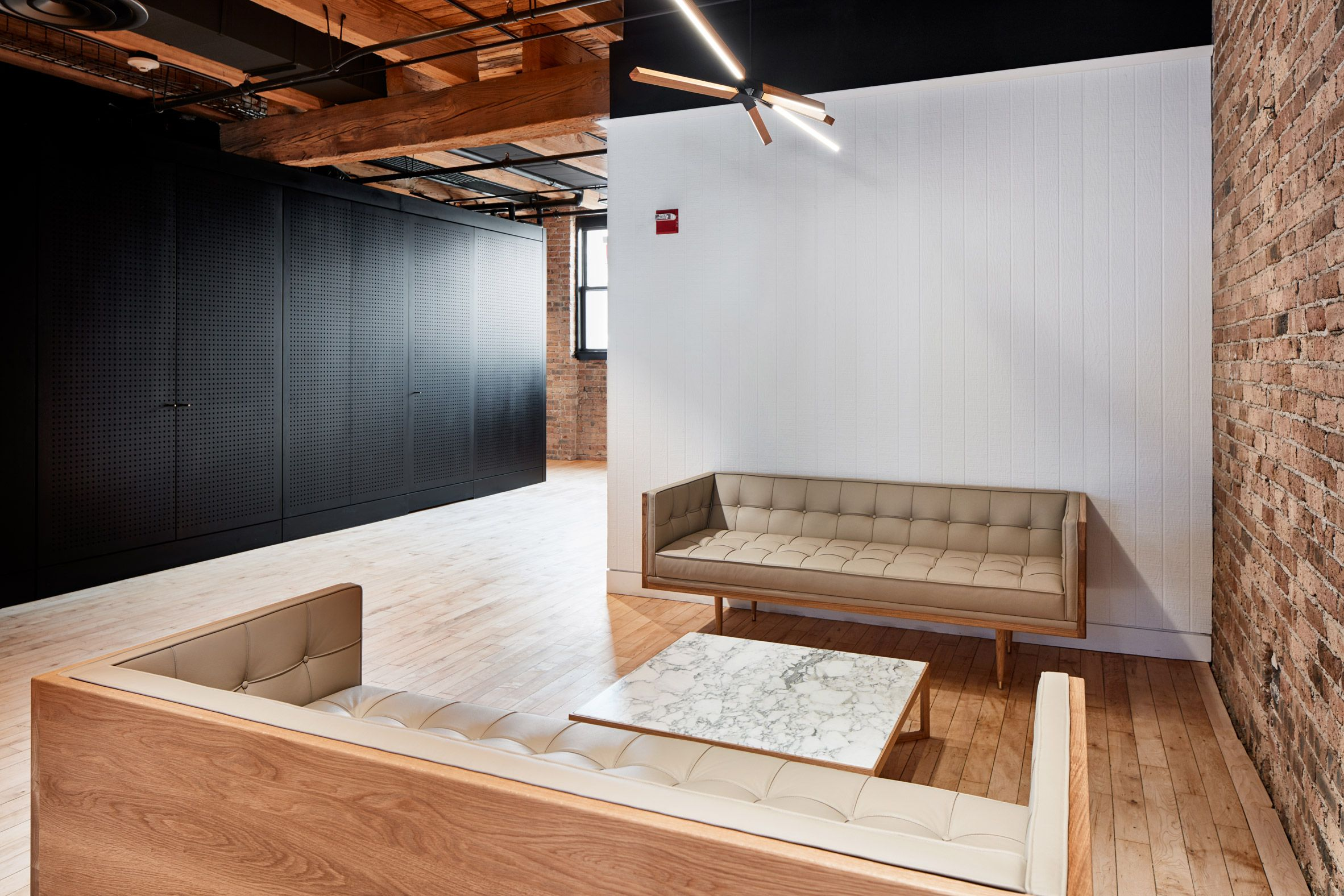 Chicago office by Those Architects has pegboard walls and a batting
