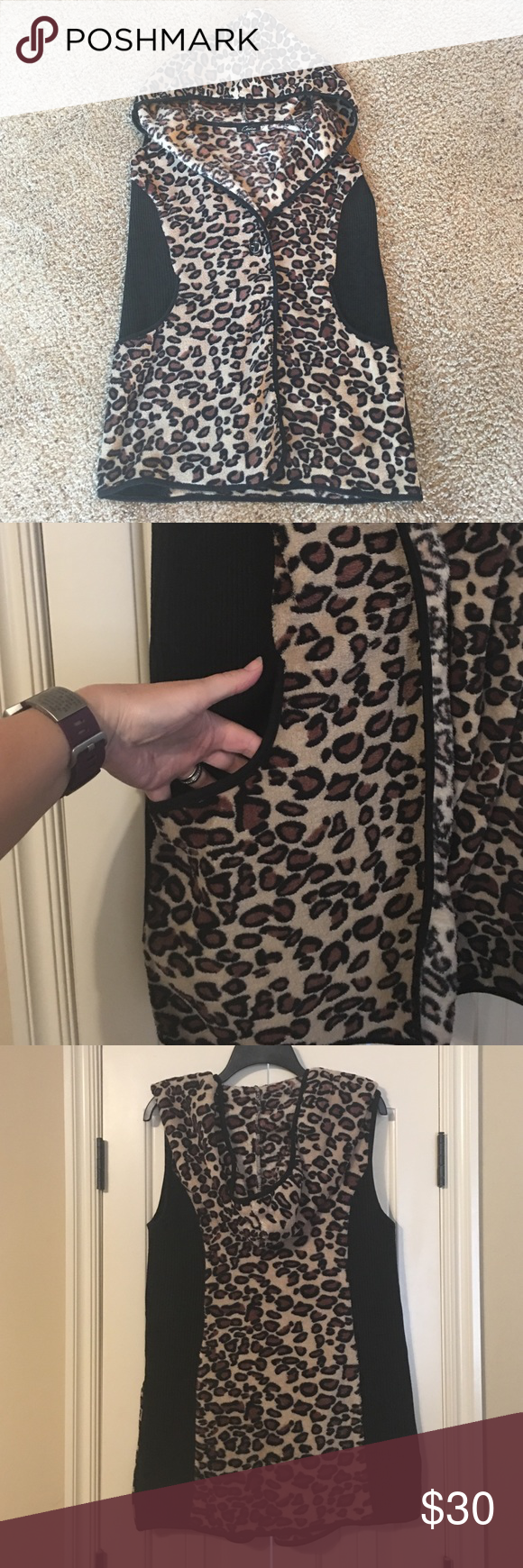 Sleeveless Leopard Print Hoodie Leopard print and black sleeveless hoodie. Black panels are ribbed. Leopard print is similar to terry cloth. Single button closure with two pockets. Boutique Tops Sweatshirts & Hoodies