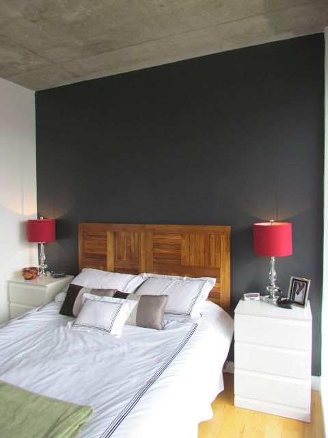 Statement navy wall and headboard made from reclaimed teak tabletops