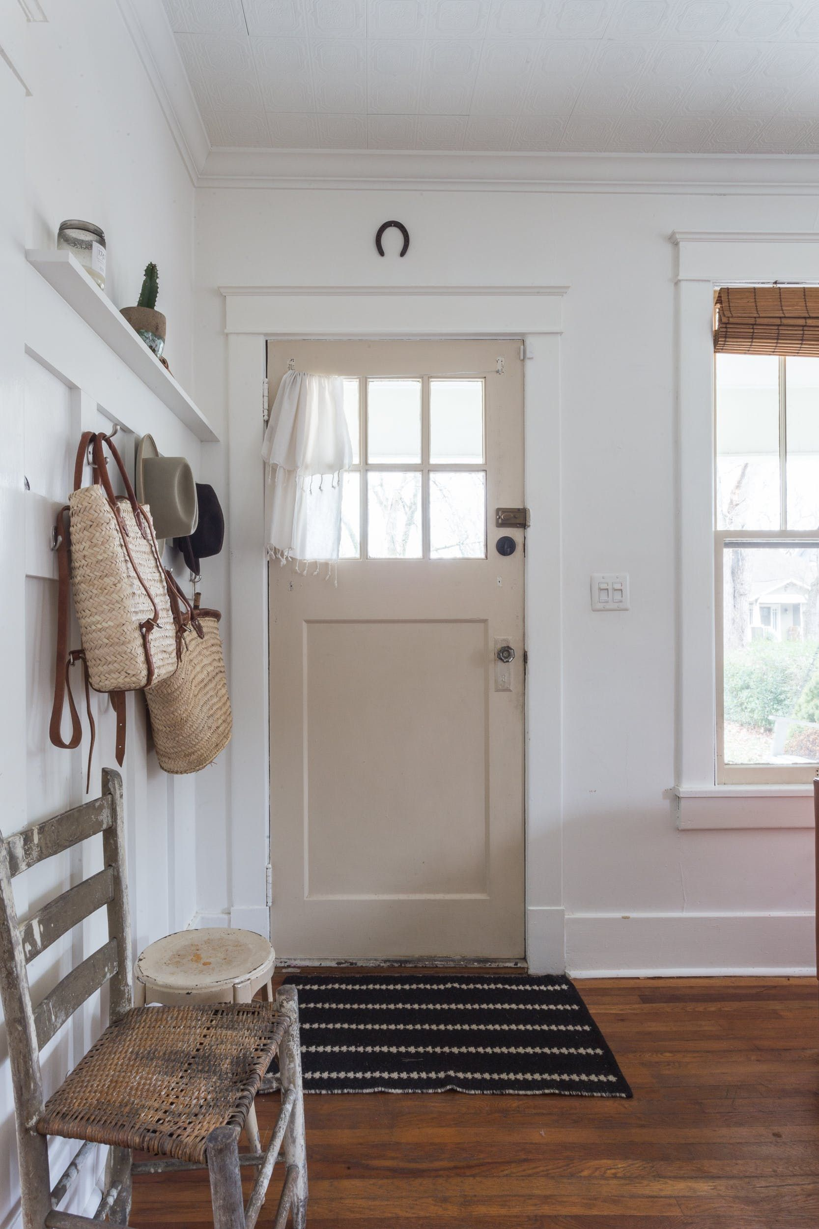 The welcoming entryway. The built-in hooks are a nice space to hang your coat and take in the beauty of Kaitie and Tyler's home.