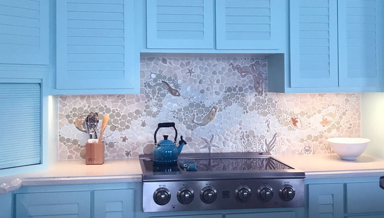 This custom nautical kitchen backsplash features our new Mermaids ...