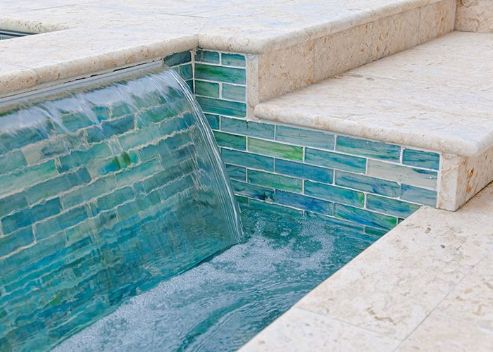 Pool tile ideas shellstone pool deck marble tile pool for Pool design tiles