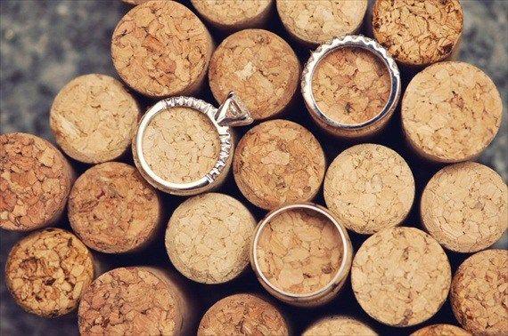 wedding ring shot on top of corks - wine themed wedding ideas