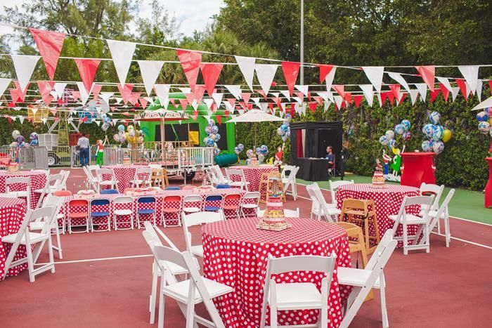 guests amid carnival themed decor - 700×467