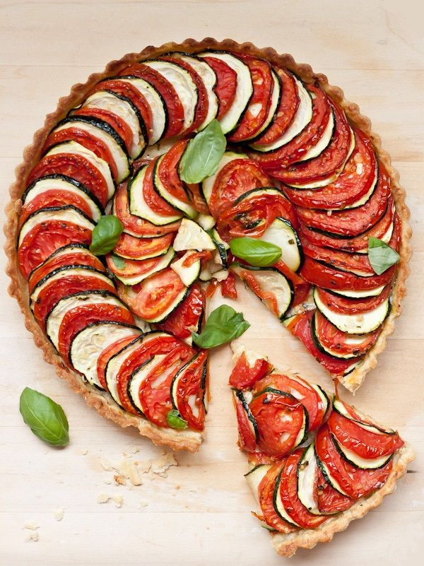 A beautiful layered tomato zucchini tart. This savory tart is easy to prepare and perfect for those summer months!