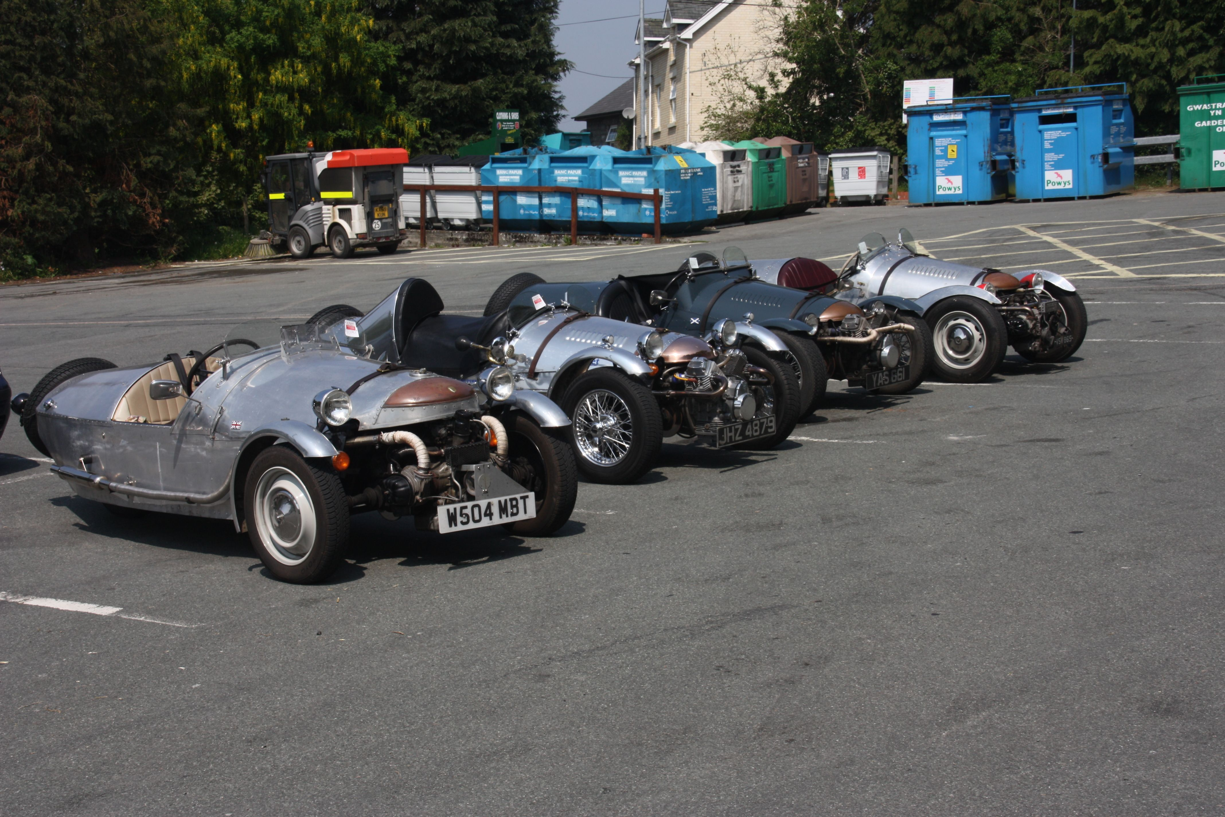 A selection of Morgan type cars spotted on a car park in Wales. ( sorry about the bins in the background )