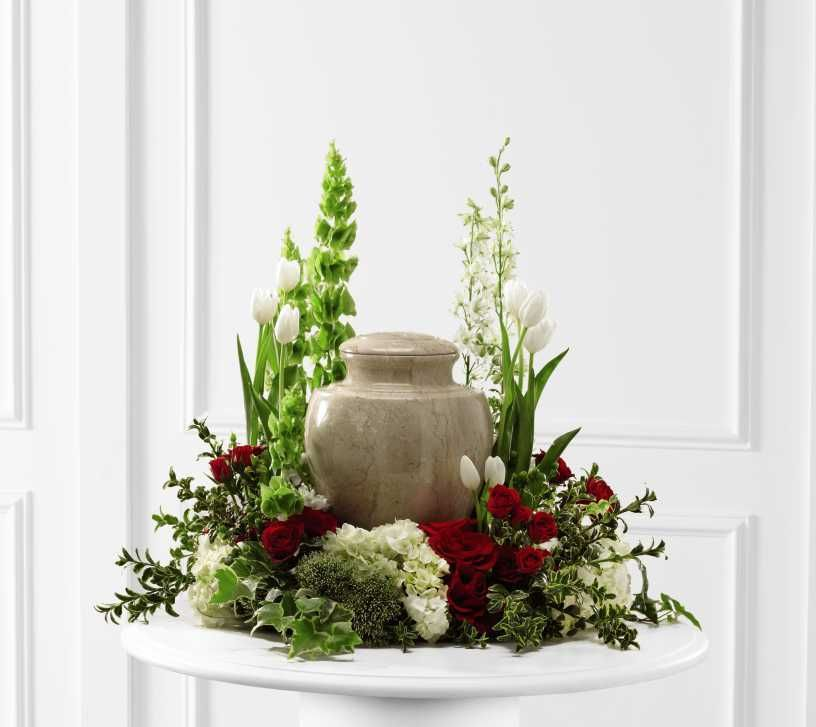 garden style floral arrangement for cremation urn memorial table at the funeral service