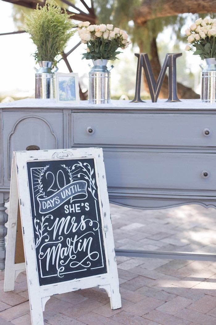 chalkboard sign decor table from a garden bridal shower via karas party ideas karaspartyideascom 50