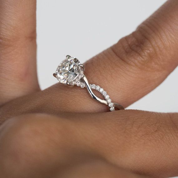Round Brilliant Cut Solitaire Engagement Ring With Twisted Infinity