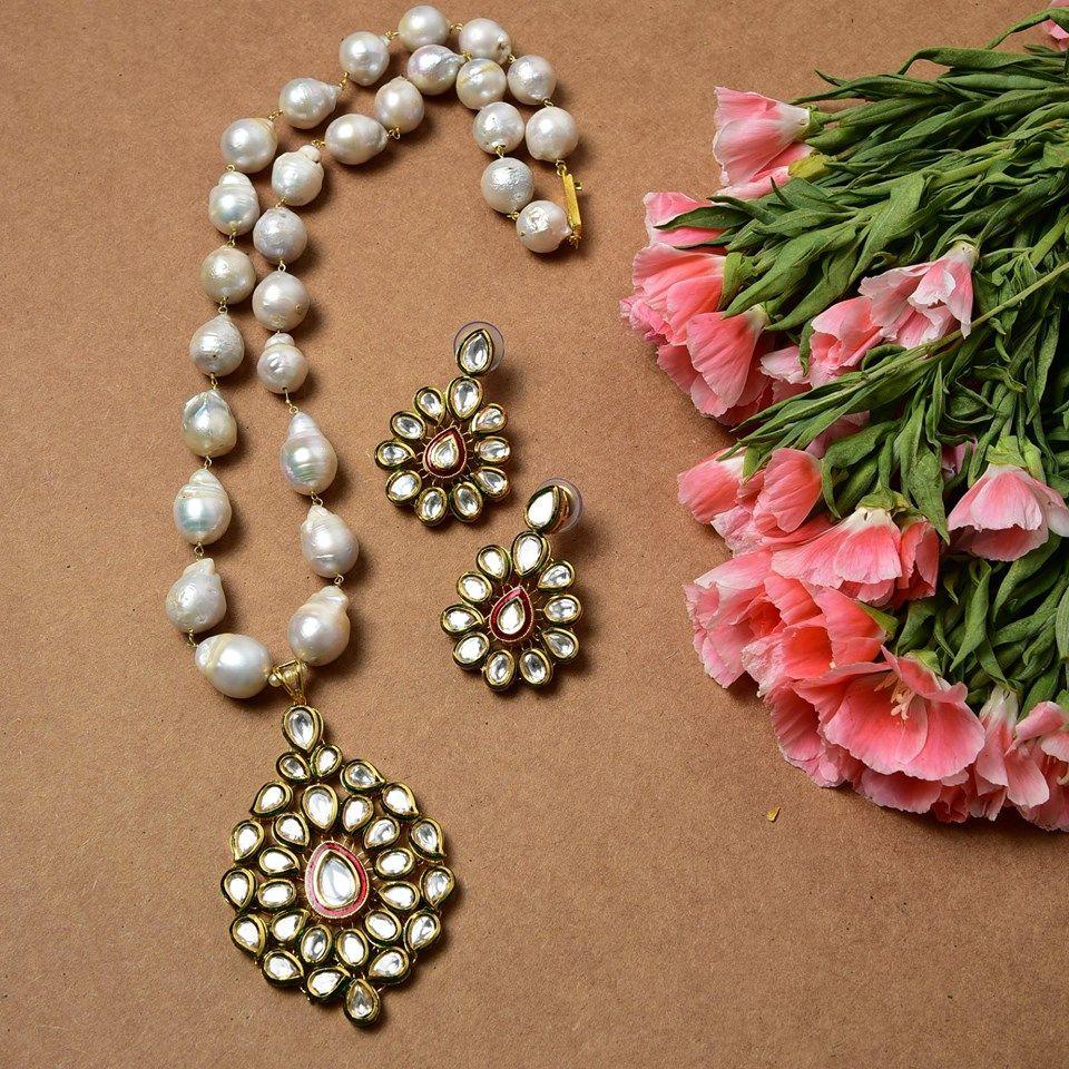 Elegant kundan pendant set with meena work is ideal to accessorise