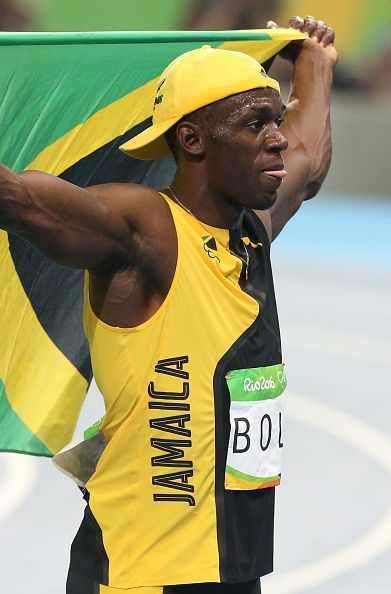 Usain Bolt of Jamaica celebrates winning the gold medal in ...