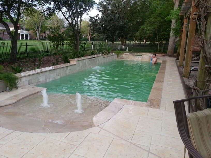 White Flagstone Beach Entry Pool With Travertine Coping And Tiles