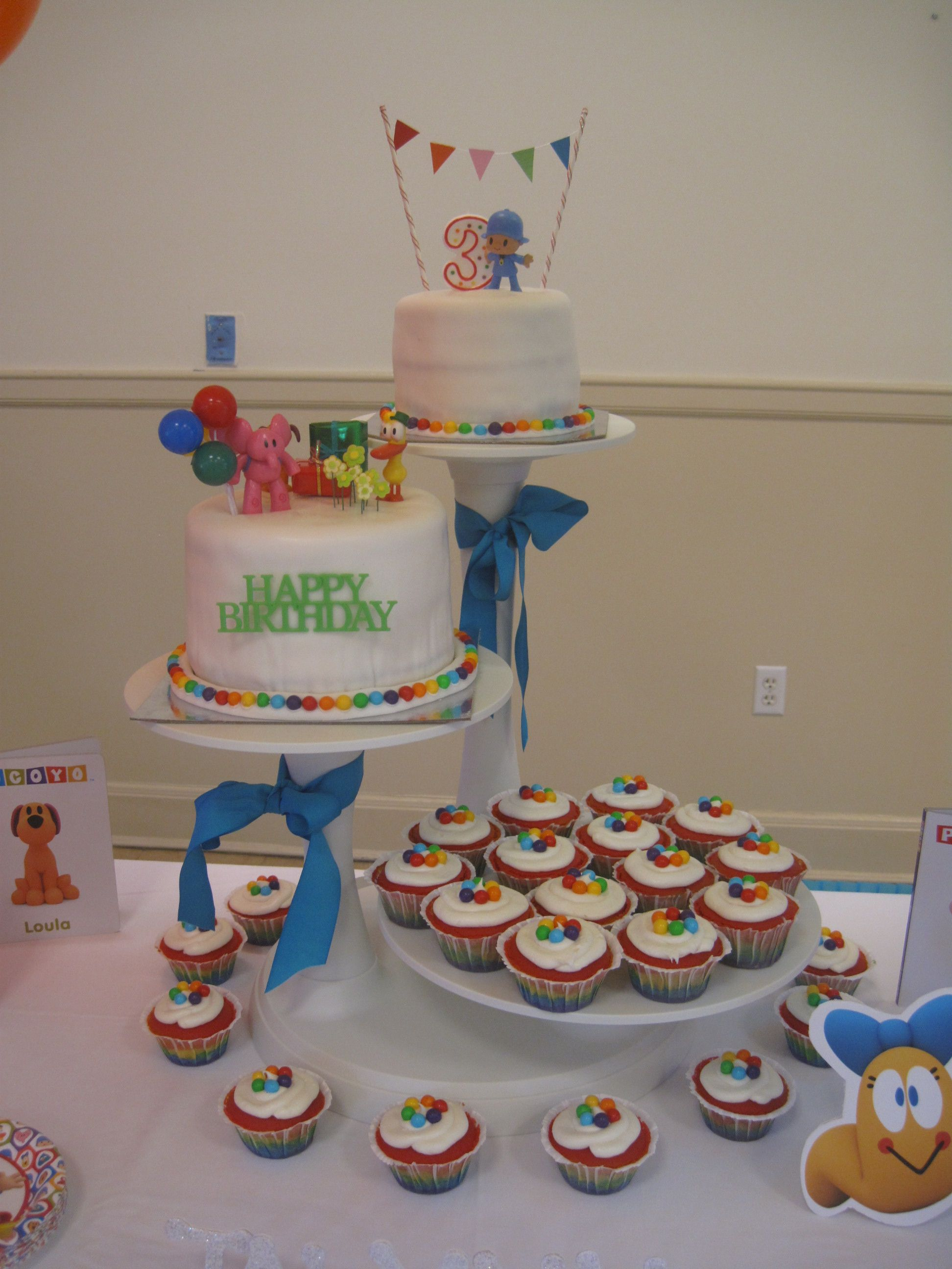 Pocoyo birthday cake primary color cupcakes with rainbow layers