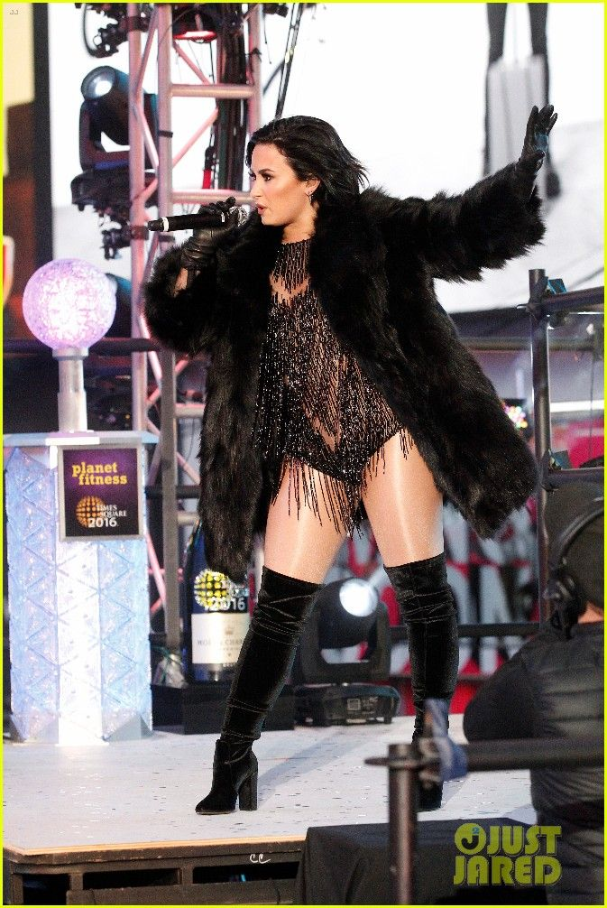 Demi Lovato in a fox fur coat at new years eve performance