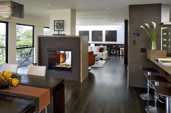 Large Open Floor Plan Featuring A Stylish Fireplace Room Dividing Structure