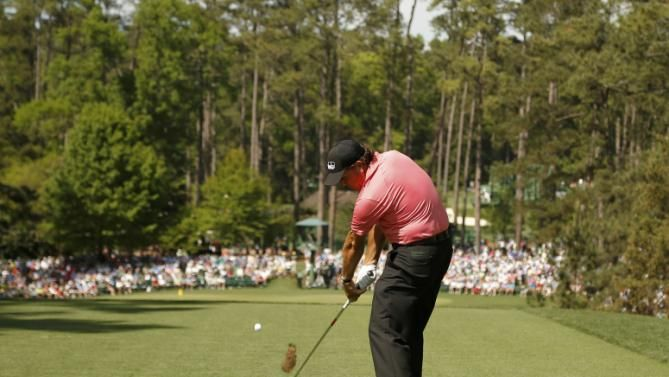 Phil Mickelson of the U.S. hits off the sixth tee during third round ...