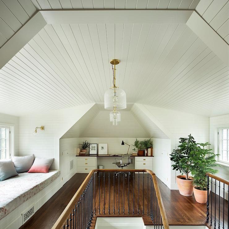 Attic work space with shiplap ceilings and a window seat