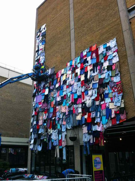 10,000 garments cover a building in London like shingles to highlight clothing waste in a campaign by UK retailer Marks & Spencer.