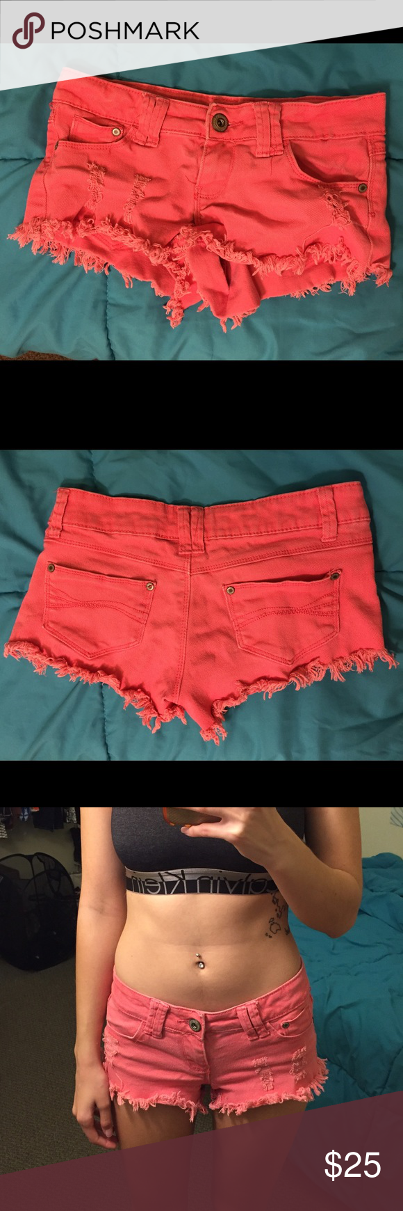 """Pink Ripped Denim Shorts Pink ripped shorts. Don't know where from, marked Roxy for exposure. Says size 0, but stretched enough to fit a 1 or 3 in the hips, but not so much in the butt, unless you don't mind less than full coverage (pulled down for pictures). Excellent used condition. Bundle 2 or more things for 10% off, and feel free to make an offer! If you want to know my measurements, check my """"Meet Your Posher"""" listing! If you have any other questions, feel free to ask!❤ Roxy Jeans"""