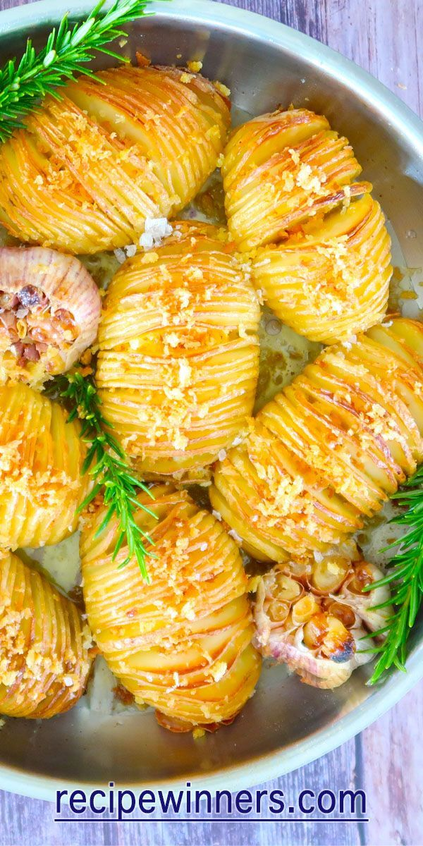 Easy Crispy Hasselback Potatoes are a great potato side, drizzled with oil, seasoned, and into the oven. Baked, then slathered in butter and buttery panko crumbs to finish. We love to bake these with whole knobs of garlic to smear over the potato leaves. Delish! Delish! #potatoes #foodporn #glutenfree #recipe #easyrecipes #vegetarian #vegetarianrecipes