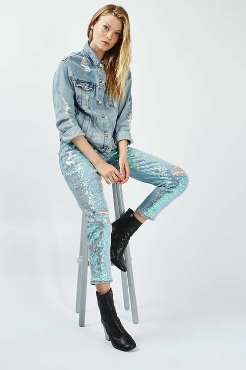 Make a cool statement with your denim this season in these low rise, oversized boyfriend jeans in bleach denim with eye-catching iridescent all over sequins. #Topshop