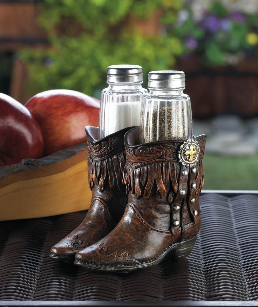 The perfect housewarming gift, this whimsical salt and pepper shaker set with holder will add a fun element anywhere you put it. From the kitchen to the dining room, this pair will keep both you and your guests amused and the food well seasoned.Material: POLYRESIN, IRON, GLASSWeight (lbs): 0.8Length (inch): 4.25Width (inch): 4.25Height (inch): 5.625