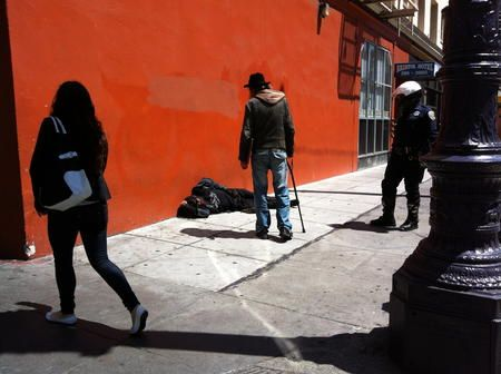 A San Francisco Police Officer Checks On A Person In The Tenderloin Photo By Michael Stoll Sf Public Press San Francisco Homeless People Tenderloins