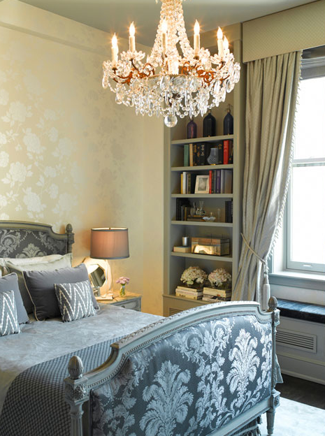glamorous bedroom with french bed upholstered in silver gray damask silk fabric gray ikat pillows