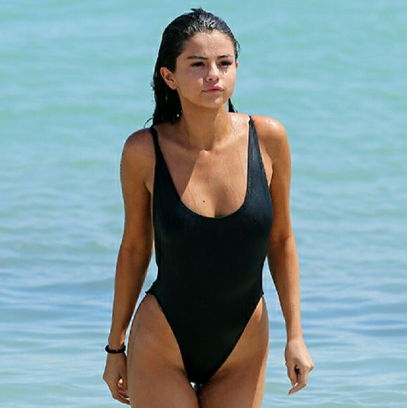 American Apparel one-piece/monokini swimsuit Seen on Kylie Jenner and Selena Gomez. High-cut waist, low and open back, great condition, never worn, inner tag still there, no outter tags. I just bought this recently and I'm 5'4 and 34B with 33 inch hips and 26 inch waist. It fits pretty well except I feel I'm an inch or two too tall so the straps dig into my shoulders a bit, which pulls up quite a bit down below; I would fit a small not xs. Hope this helps with any questions regarding the…