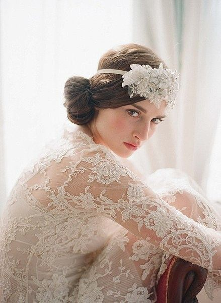 Long sleeve lace #wedding dress with headpiece - via Trend Wedding.