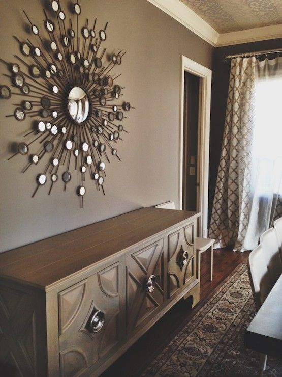 Taupe Dining Room Features Sunburst Mirror Over Buffet Cabinet Global Views Westmoreland Against Walls Adjacent To Wall With Windows