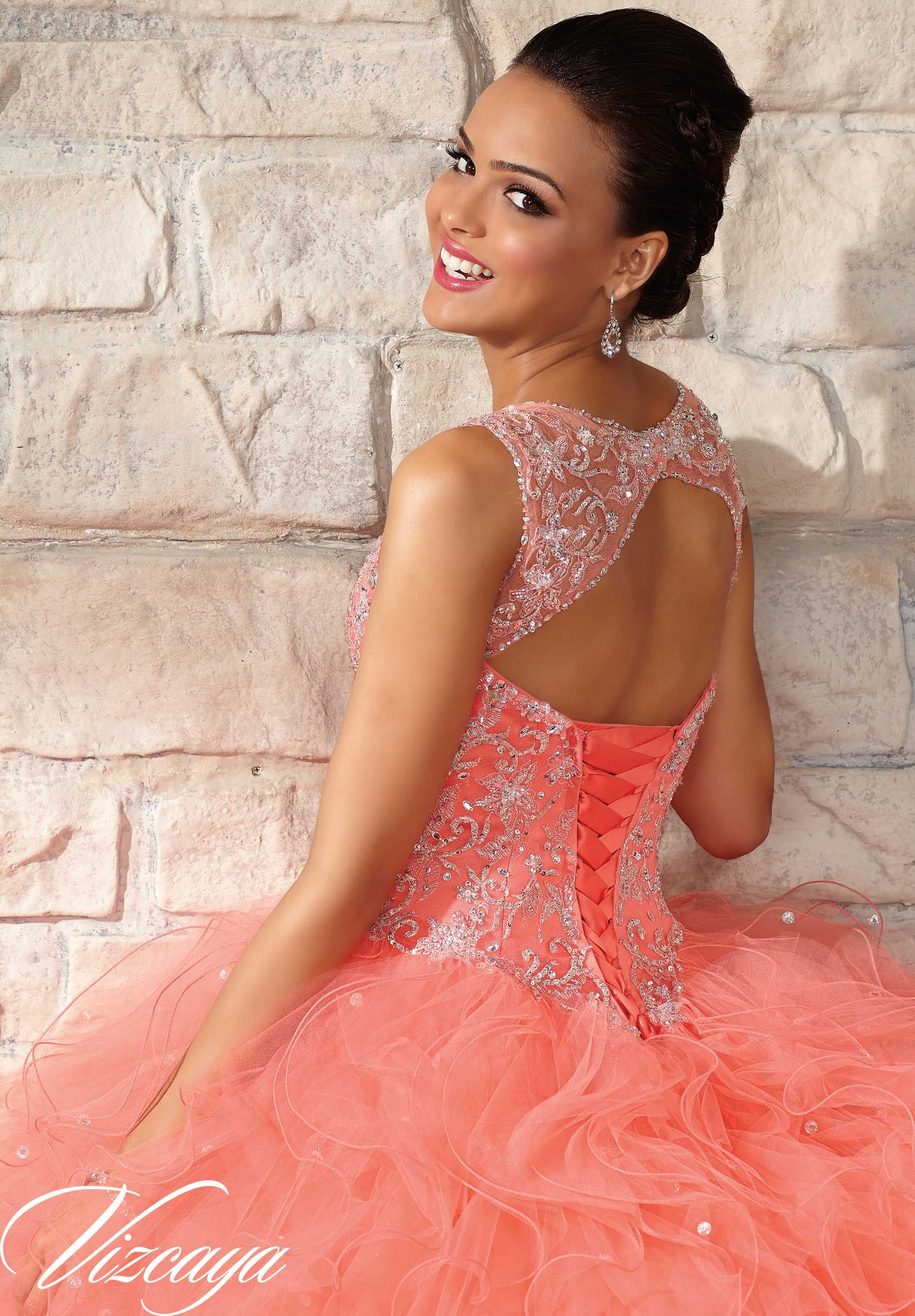 4fccf8e930f 89027 Quinceanera Gowns Embroidered and Beaded Bodice on a Ruffled Tulle  Skirt. Hot Pink