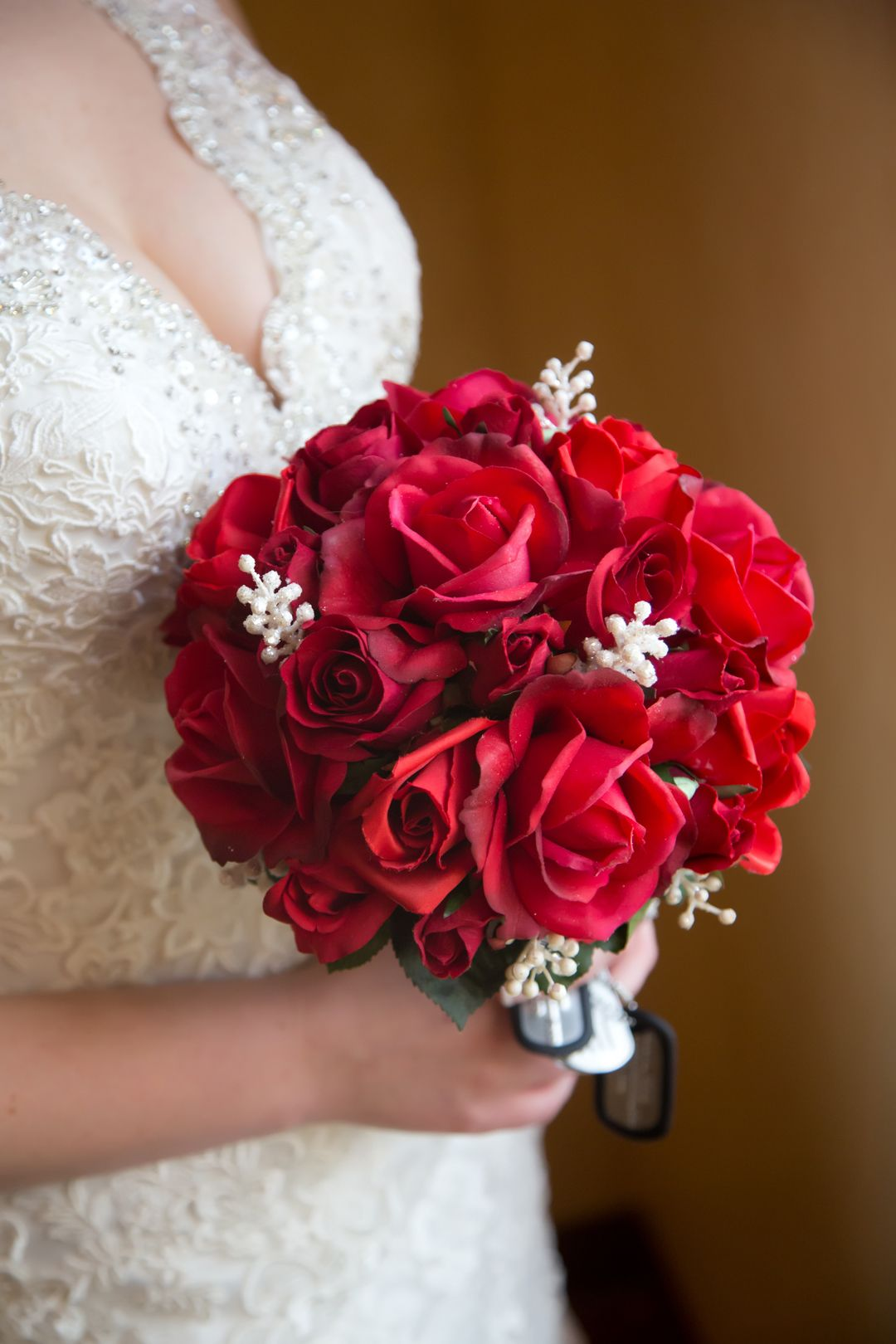 Real Touch red roses mixed with silk ones give this military bride's bouquet the most realistic look. (Photo by Redford and provided with permission by the couple.)