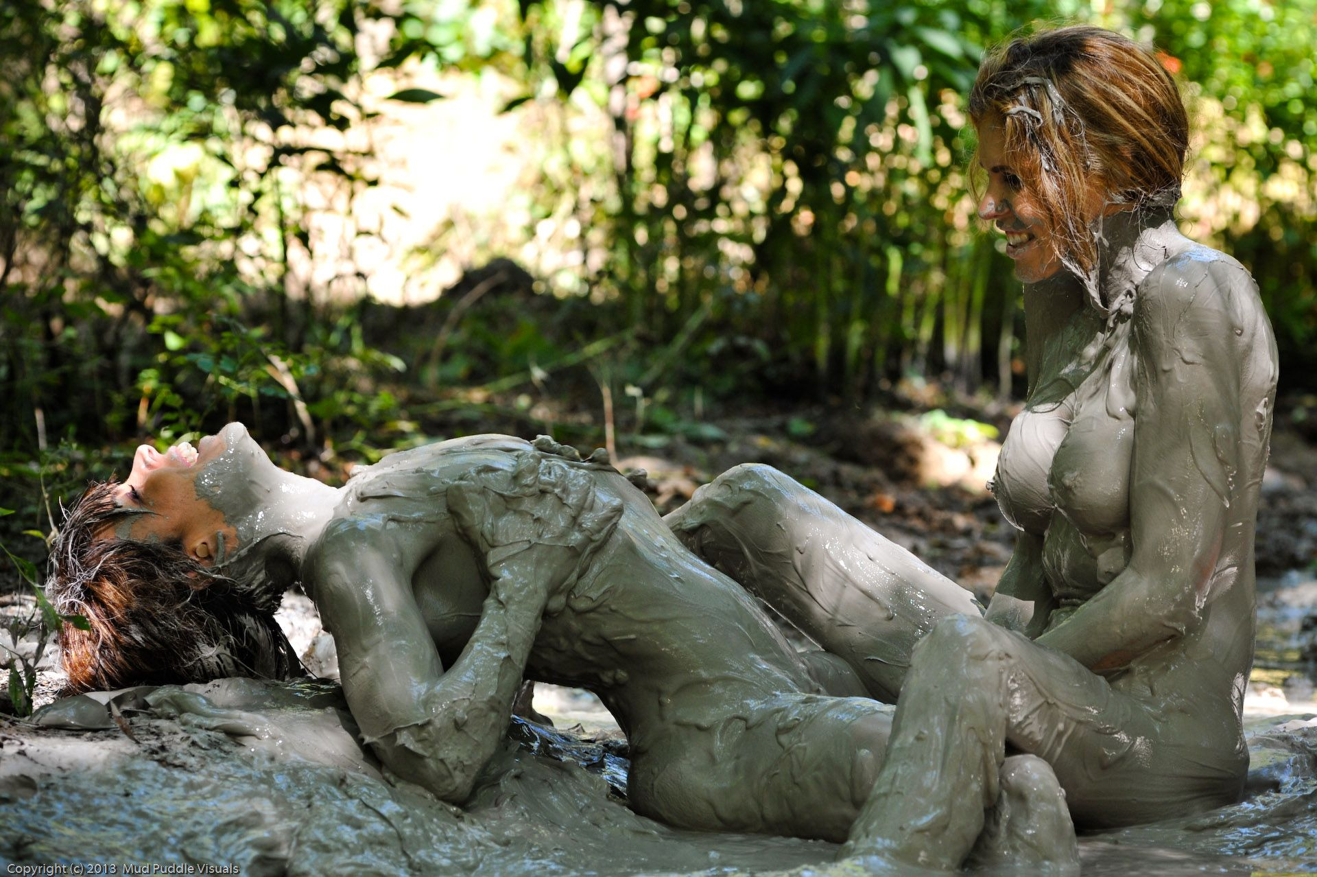 girl naked mud bath