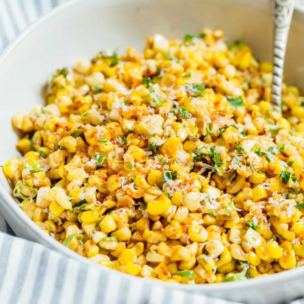 A less messy way to eat Mexican street corn! This Mexican street corn off the cob is one you'll want to make for all your parties year-round! #mexicanstreetcorn #corn #mexican #sidedish #cornrecipe #mexicanstreetcorn