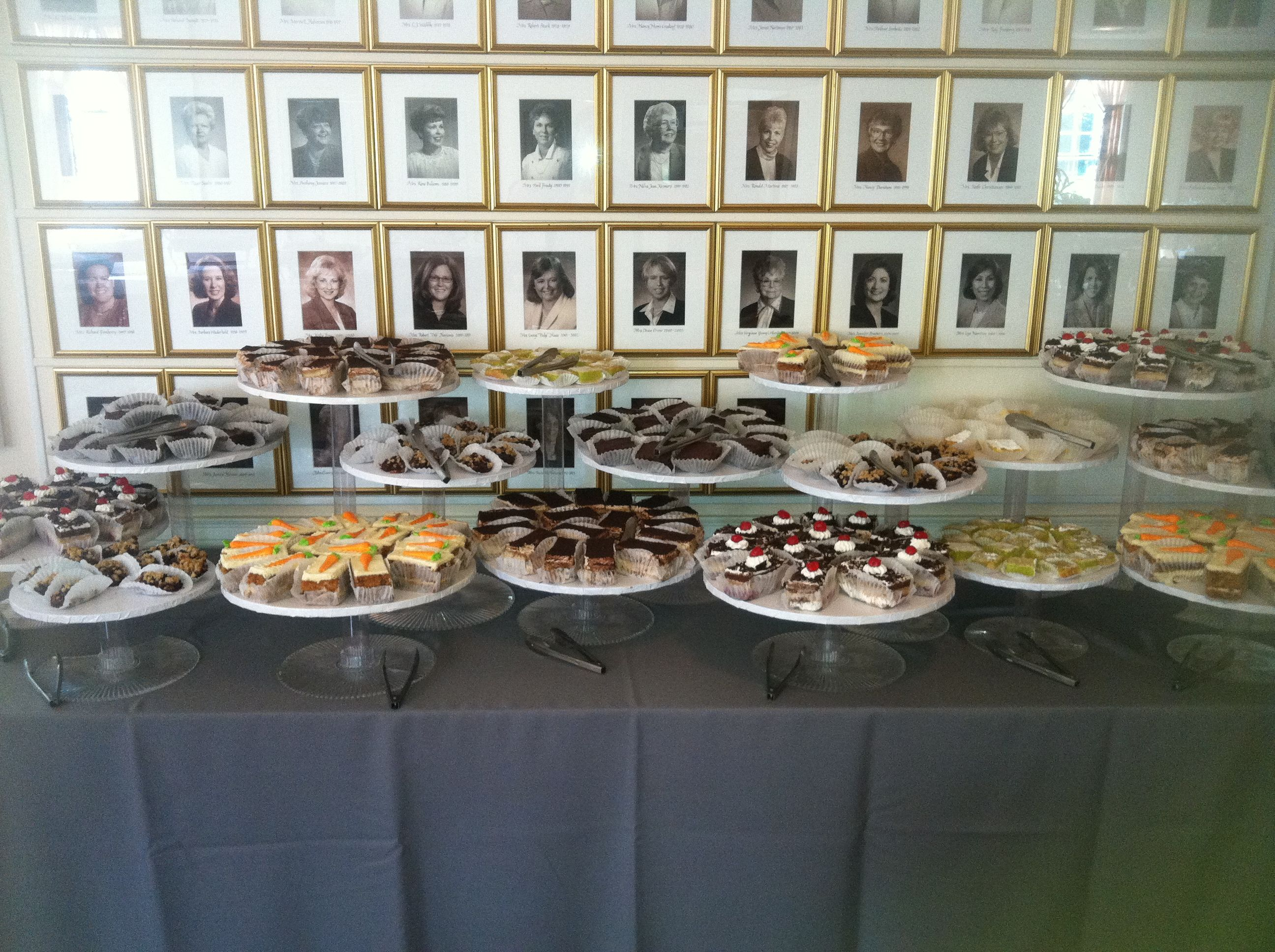 Sweets table containing a variety of desserts.
