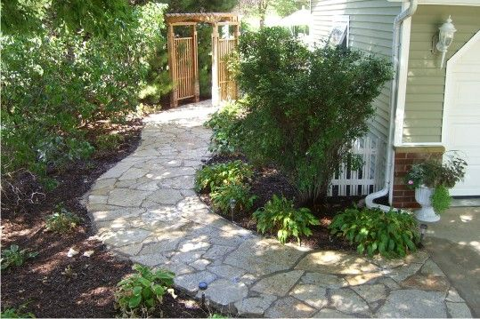 Adding A Decorative Stone Walkway From Your Driveway To A Side Or Rear Yard Or Entryway Adds