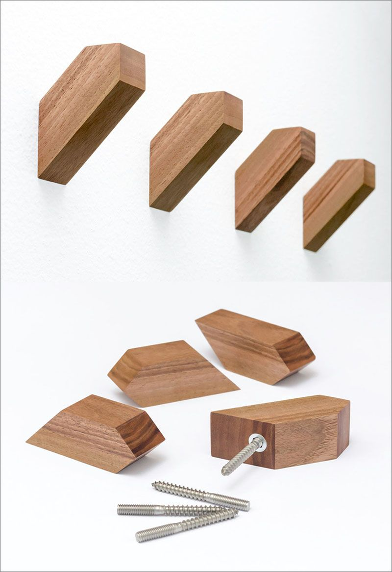These geometric wood wall hooks are made from european walnut and have a simple and understated design