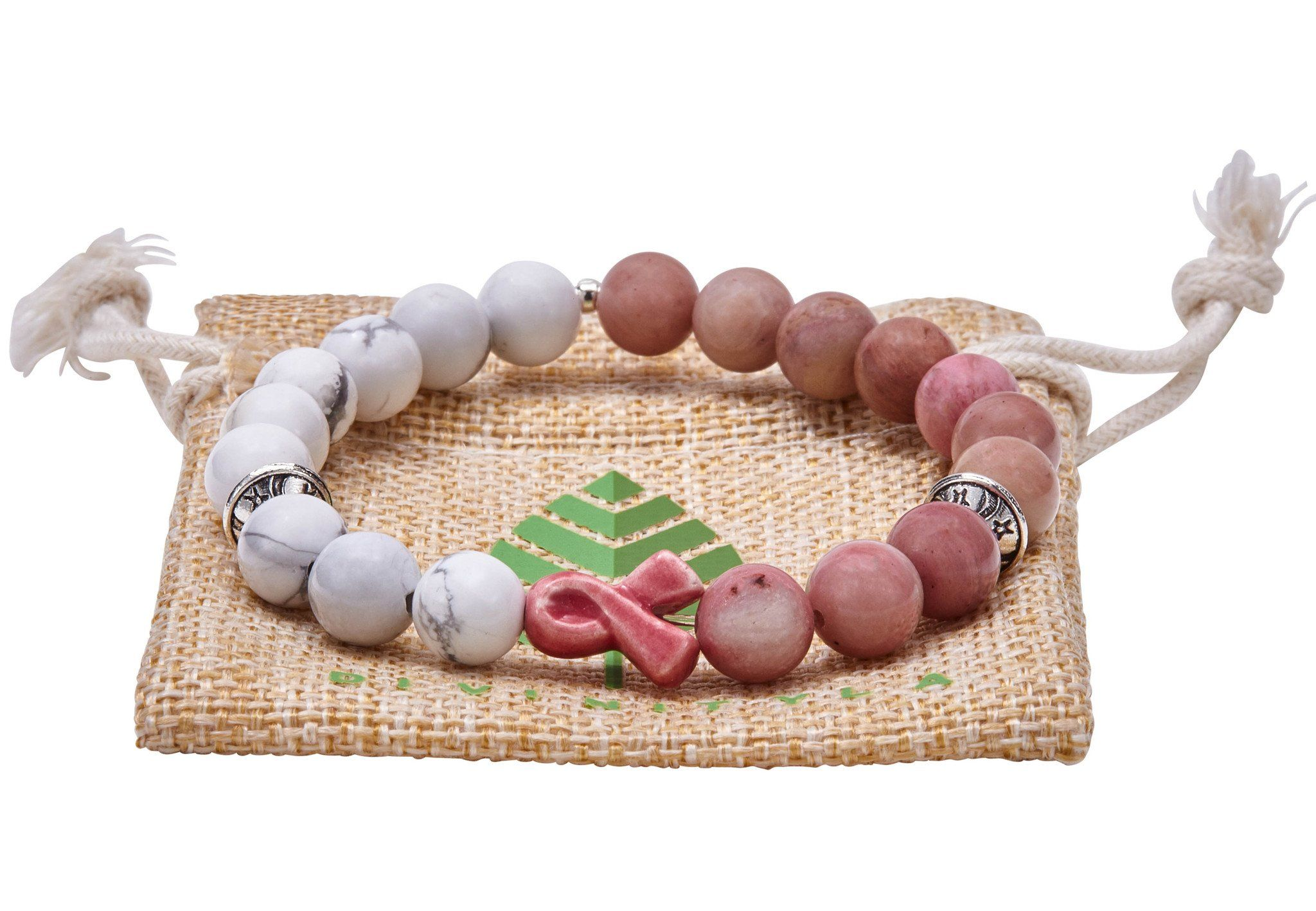 Breast Cancer - Howlite - Rhodonite Celebrating October as Breast Cancer Awareness Month! A most meaningful accessory showing unconditional support for all those whose lives have been touched by breast cancer. This bracelet opens the heart to an abundance of love and healing while encouraging compassion for all aspects of life. Its stones possess tangible calming effects that are known to decrease stress and anxiety. 10% of our profits from this bracelet will be donated to Relay for Life