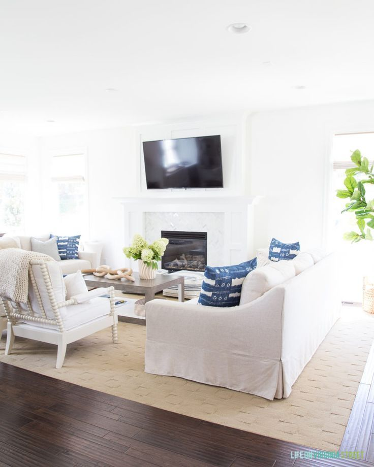 A coastal inspired living room with linen slipcovered
