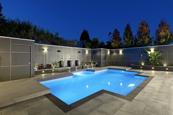 Wonderful Swimming Pool Designs With Modern Style Using Concrete Tile Flooring And Outdoor Lighting Design