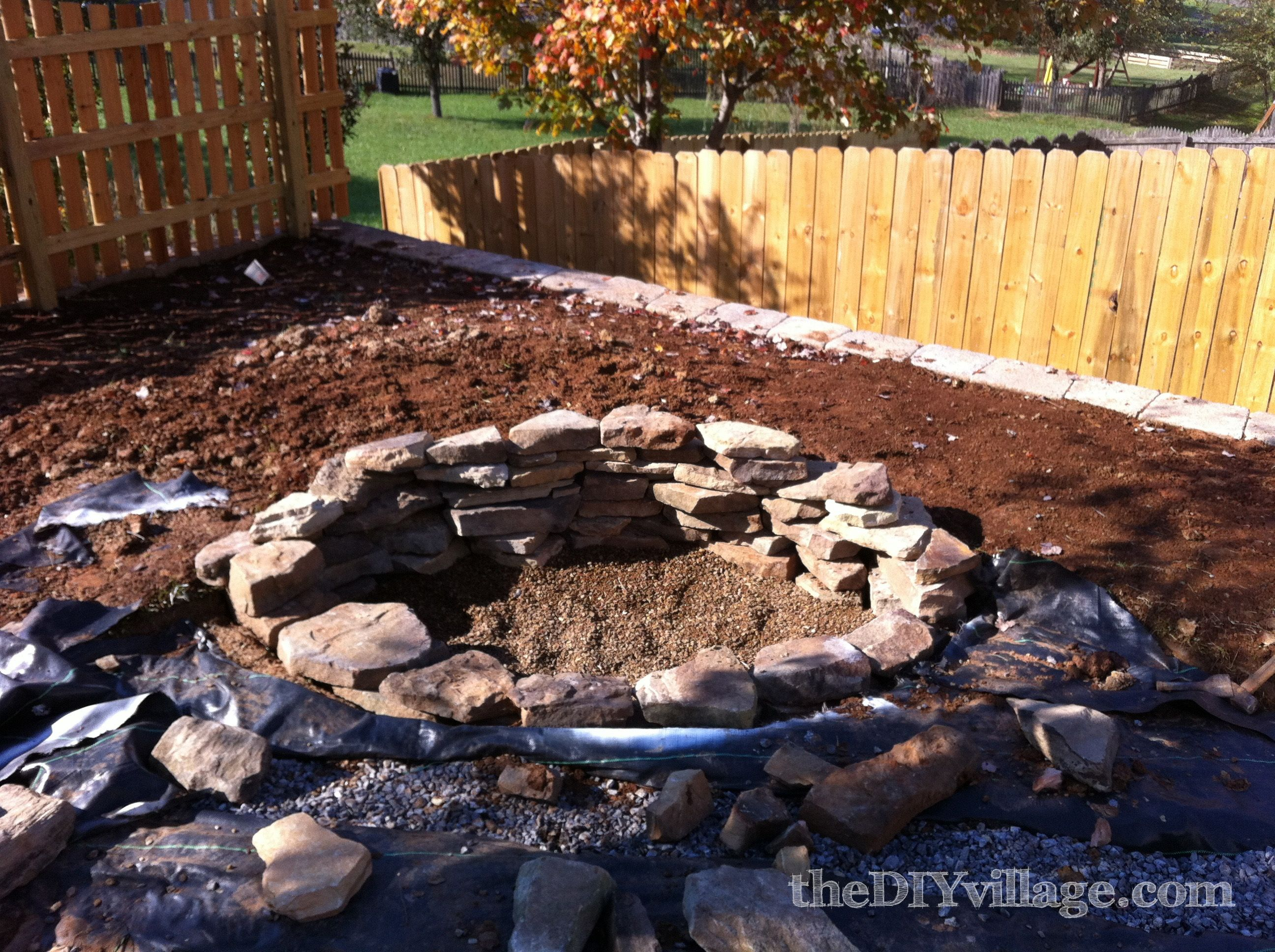 Building A Stacked Stone Fire Pit Fire Pit Landscaping Concrete