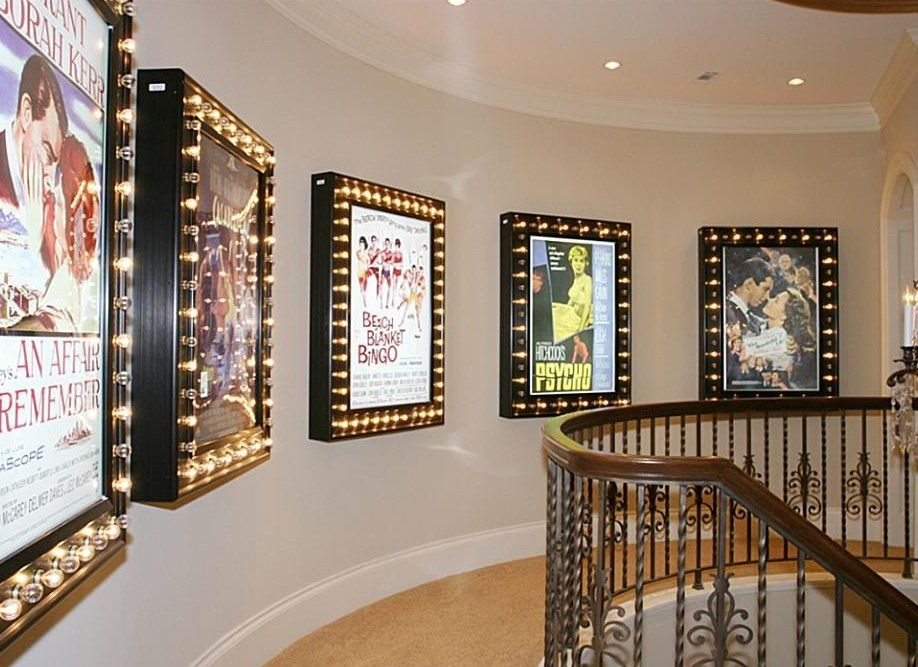 The Hallway Upstairs Is Framed By Movie Posters With Light Fixtures Movie Room Decor Home Cinema Room Theater Room Decor