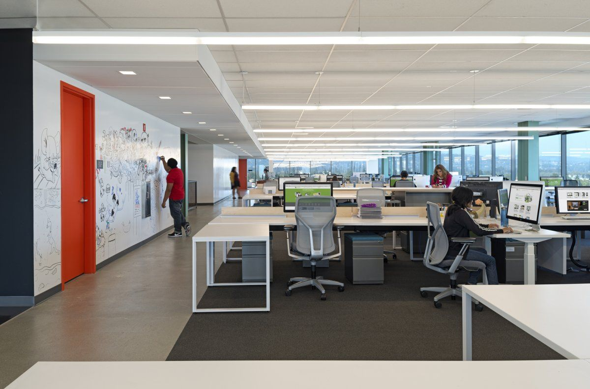 Evernote open plan with concrete for hallway and carpet under desks