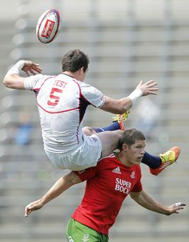 Zach Test of the United States and Carl Murray of Portugal battle for the ball in the Bowl Semi Final match during Day 2 of the Tokyo Sevens rugby tournament Japan.