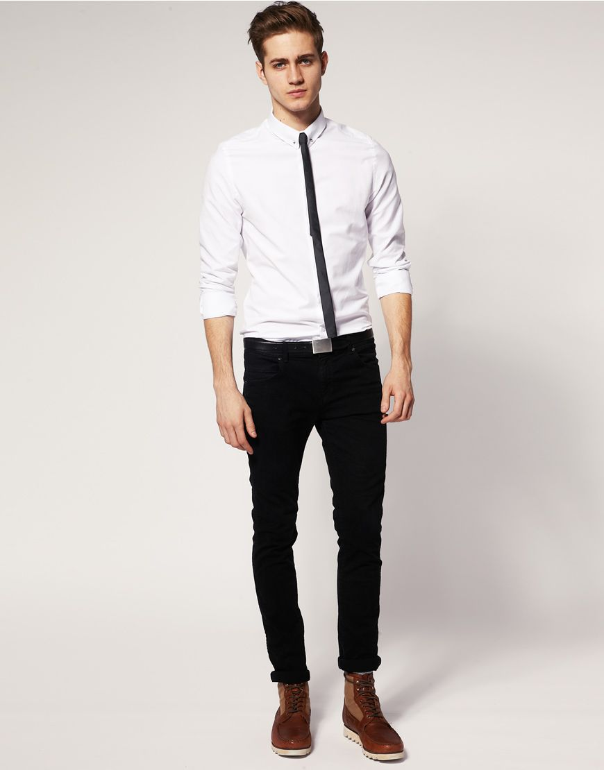 Casual fancy thin black tie, solid white shirt, black pants, boots.