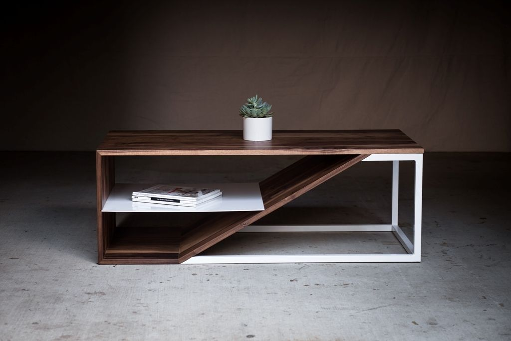 The Cortadao Coffee Table was designed to showcase the beauty of simplicity and clean lines. Harkavy Furniture uses walnut and powder coated steel to create a visually balanced piece that will last a lifetime.