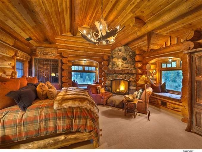 cozy log cabin bedroom with fireplace #LogHomes Cabin in 2018