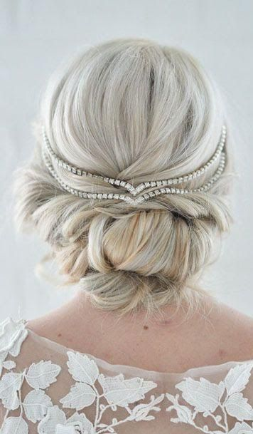 This wedding hairstyle features a stunning diamond headpiece! Want to see more great looks? These are great
